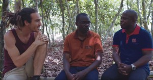 Siriki Diakité from UTZ (right) and the Nestlé Cocoa Plan manager talk about better farming practices with blogger Louis Cole.
