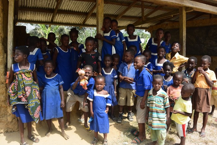 Children going to school in a cocoa community in Ghana