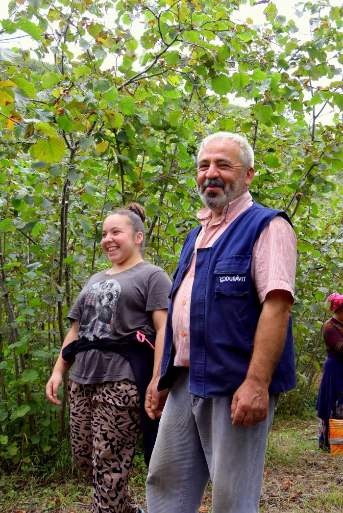 Turkish hazelnut farmer Orhan Güler and his daughter